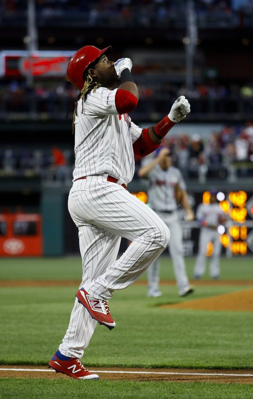 Philadelphia Phillies' Maikel Franco reacts as he rounds the bases after hitting a three-run home run off New York Mets starting pitcher Steven Matz, background, during the first inning of a baseball game, Tuesday, April 16, 2019, in Philadelphia. (AP Photo/Matt Slocum)