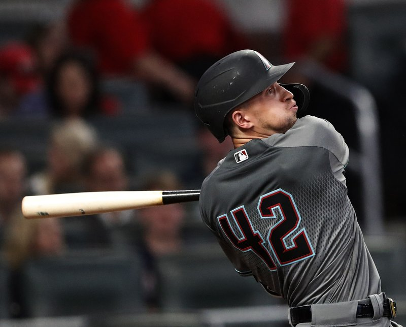 Arizona Diamondbacks shortstop Nick Ahmed (13) drives in a run with a base hit in the fourth inning of a baseball game against the Atlanta Braves, Tuesday, April 16, 2019, in Atlanta. (AP Photo/John Bazemore)