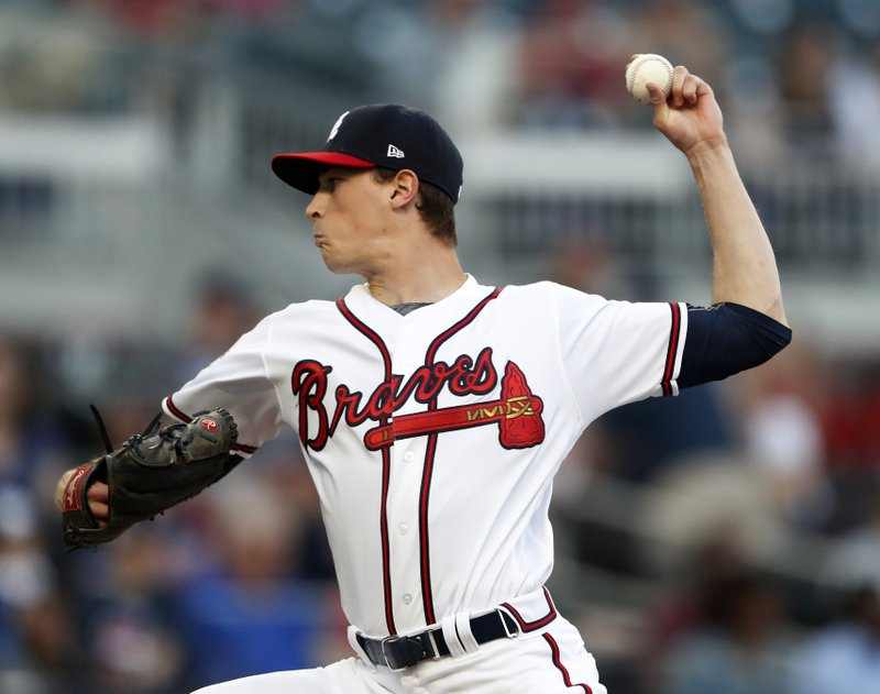 Atlanta Braves starting pitcher Max Fried (54) works in the first inning of a baseball game against the Arizona Diamondbacks, Tuesday, April 16, 2019, in Atlanta. (AP Photo/John Bazemore)