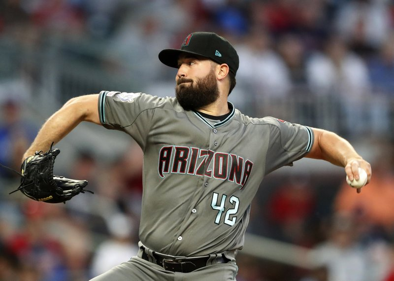 Arizona Diamondbacks starting pitcher Robbie Ray works in the third inning of a baseball game against the Atlanta Braves, Tuesday, April 16, 2019, in Atlanta. (AP Photo/John Bazemore)