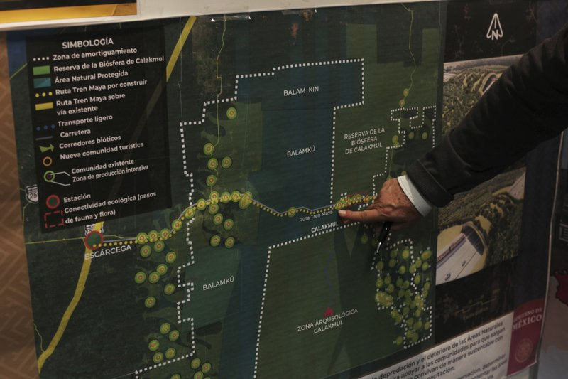 Rogelio Jiménez Pons, director of Fonatur, points to a map of a planned train line through the Yucatan Peninsula, during an interview in Mexico City, Monday, March 18, 2019. (AP Photo/Marco Ugarte)