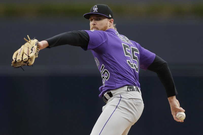 Colorado Rockies starting pitcher Jon Gray works against a San Diego Padres batter during the first inning of a baseball game Tuesday, April 16, 2019, in San Diego. (AP Photo/Gregory Bull)