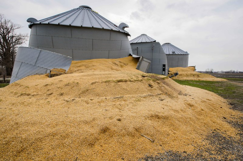 In this Wednesday, April 10, 2019 photo, flooding causes corn to burst out of a grain silos on a farm in Bellevue, Neb. (AP Photo/Nati Harnik)