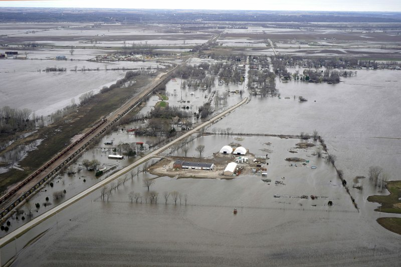 In this Friday, April 12, 2019 photo, the flooded town of Pacific Junction, Iowa, is seen from above. (AP Photo/Nati Harnik)