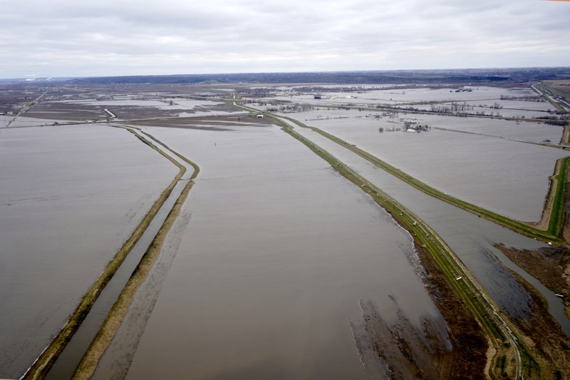 In this Friday, April 12, 2019 photo, levees built to protect fields from floods, are seen in flooded fields near Pacific Junction, Iowa. (AP Photo/Nati Harnik)