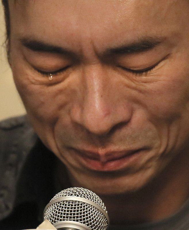 Hong Kong singer Andy Hui attends a press conference about his affair in Hong Kong, Tuesday, April 16, 2019. (AP Photo/Vincent Yu)