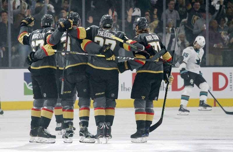 Vegas Golden Knights celebrate after left wing Max Pacioretty, left, scored against the San Jose Sharks during the first period of Game 4 of a first-round NHL hockey playoff series Tuesday, April 16, 2019, in Las Vegas. (AP Photo/John Locher)