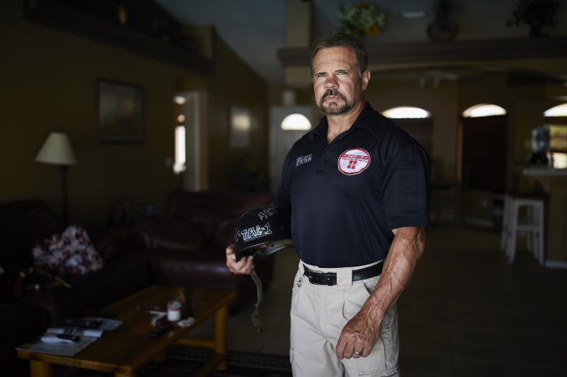 In this April 9, 2019, photo, Grant Whitus poses for a portrait at his home in Lake Havasu City, Ariz. (AP Photo/John Locher)