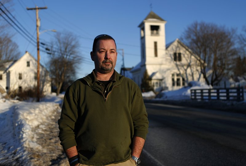 In this Tuesday, March 12, 2019 photo, former SWAT officer Al Joyce walks in Norway, Maine. Joyce left his job in law enforcement in Jefferson County, Colorado, after a school shooting and now works as a cashier. (AP Photo/Robert F. Bukaty)