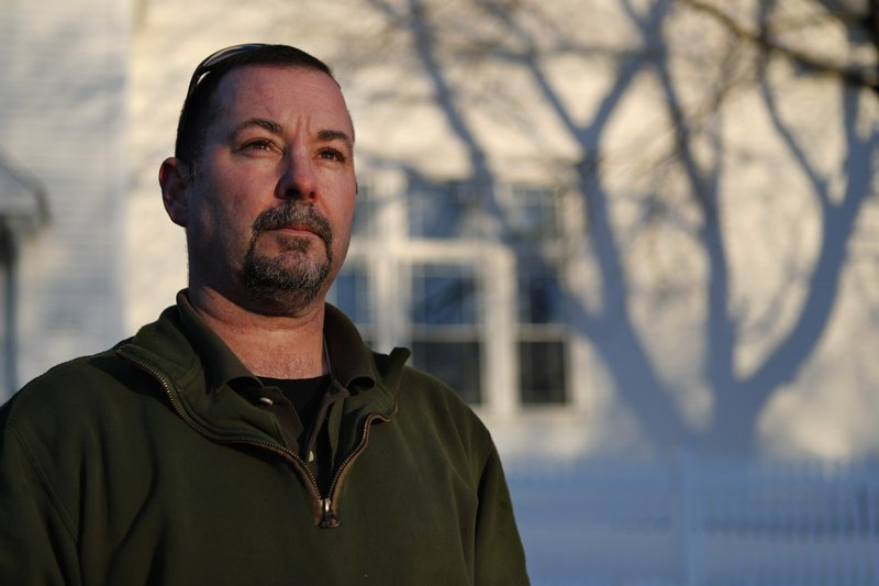In this Tuesday, March 12, 2019 photo, former SWAT officer Al Joyce poses in Norway, Maine. Joyce left his job in law enforcement in Jefferson County, Colo. (AP Photo/Robert F. Bukaty)