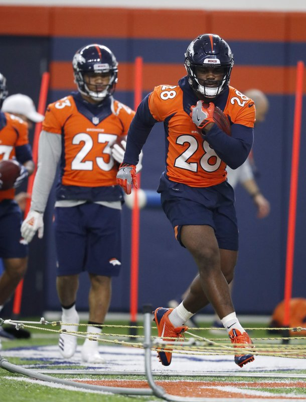 Denver Broncos running back Royce Freeman takes part in drills during the NFL football team's veterans minicamp Tuesday, April 16, 2019, in Englewood, Colo. (AP Photo/David Zalubowski)