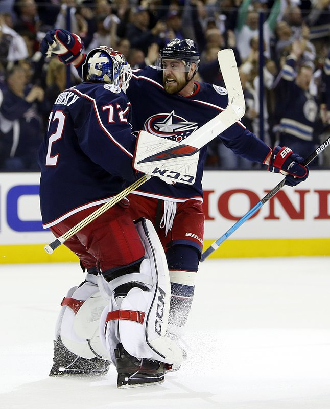 Columbus Blue Jackets' Sergei Bobrovsky, left, of Russia, and Brandon Dubinsky celebrate their win over the Tampa Bay Lightning in Game 4 of an NHL hockey first-round playoff series, Tuesday, April 16, 2019, in Columbus, Ohio. (AP Photo/Jay LaPrete)