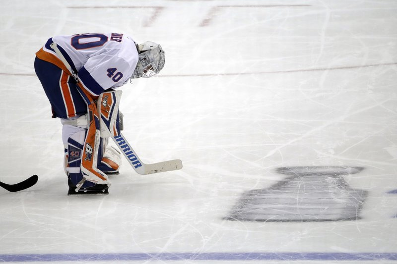 New York Islanders goaltender Robin Lehner collects himself during a timeout in the third period in Game 4 of the team's NHL first-round hockey playoff series against the Pittsburgh Penguins in Pittsburgh, Tuesday, April 16, 2019. (AP Photo/Gene J. Puskar)