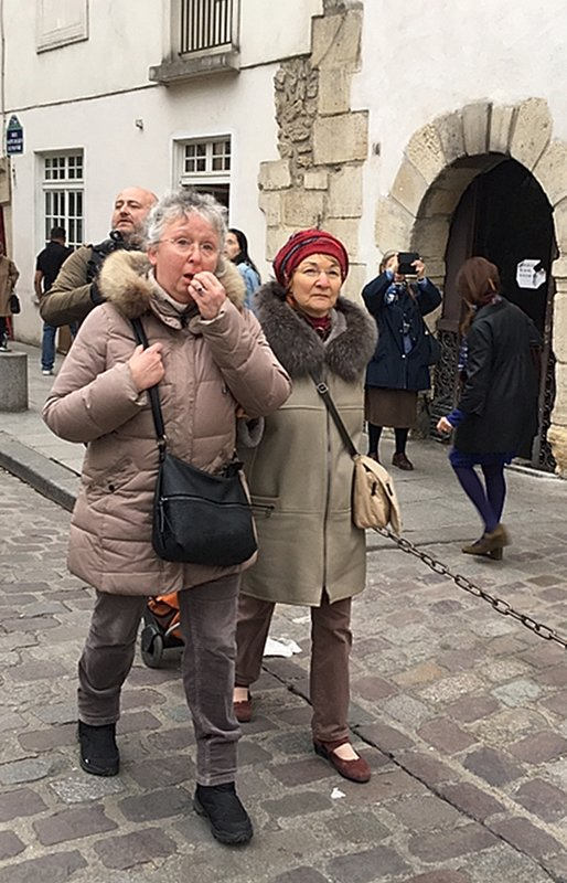 Cecile Deleville, left, and her friend Benedicte Havas walk in Paris Tuesday April 16, 2019. For the 66-year-old Deleville, there is no replacement for Notre Dame, where she worshipped regularly, sometimes daily, for two decades. (AP Photo/Elaine Ganley)