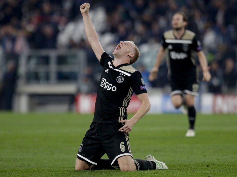 Ajax's Donny van de Beek celebrates at the end of the Champions League, quarterfinal, second leg soccer match between Juventus and Ajax, at the Allianz stadium in Turin, Italy, Tuesday, April 16, 2019. (AP Photo/Luca Bruno)