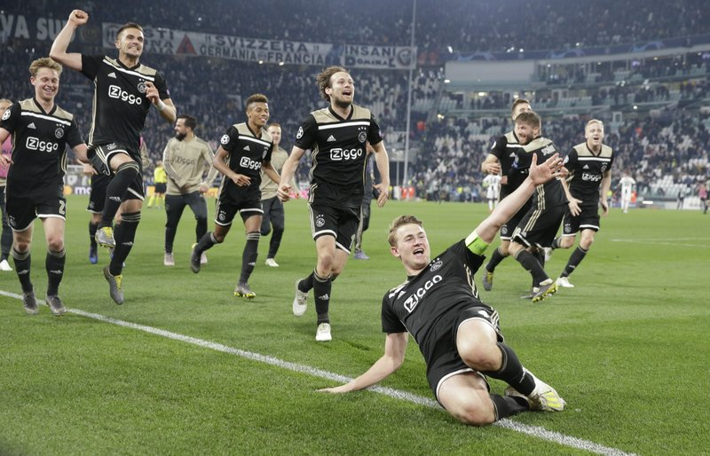 Ajax's Matthijs de Ligt and teammates celebrate at the end of the Champions League, quarterfinal, second leg soccer match between Juventus and Ajax, at the Allianz stadium in Turin, Italy, Tuesday, April 16, 2019. (AP Photo/Luca Bruno)
