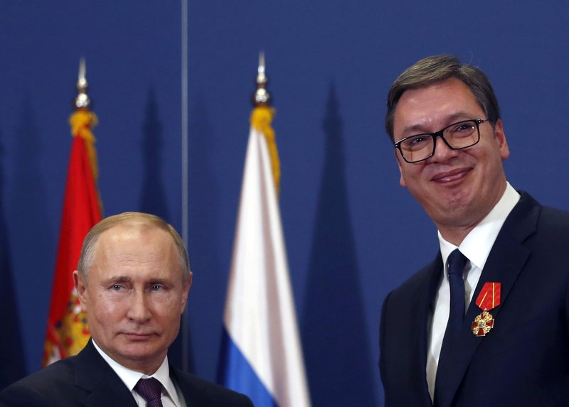 FILE - In this photo taken Thursday, Jan. 17, 2019, Russian President Vladimir Putin, left, poses with Serbian President Aleksandar Vucic after being awarded the Order of Alexander Nevsky in Belgrade, Serbia. (AP Photo/Darko Vojinovic)