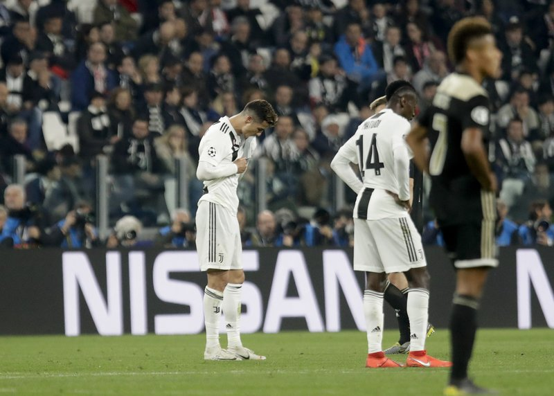 Juventus' Cristiano Ronaldo walks off the pitch at the end of the Champions League, quarterfinal, second leg soccer match between Juventus and Ajax, at the Allianz stadium in Turin, Italy, Tuesday, April 16, 2019. (AP Photo/Luca Bruno)