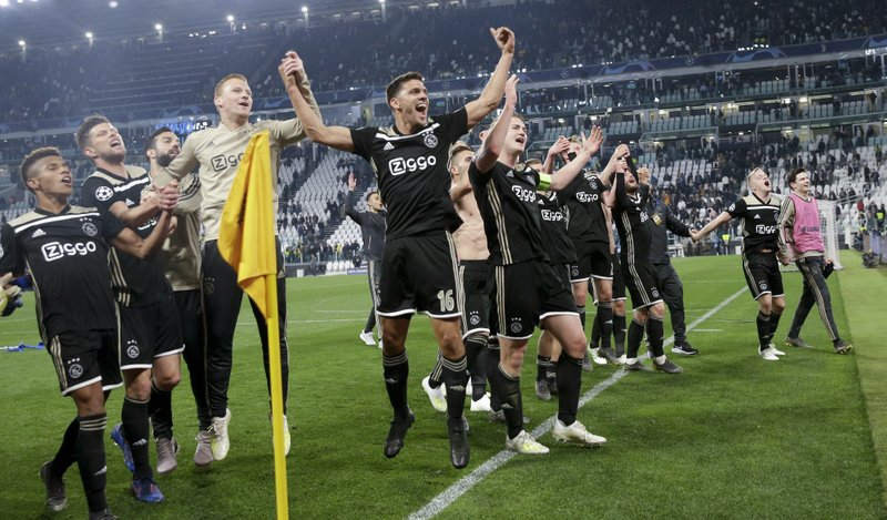 Ajax players celebrate at the end of the Champions League, quarterfinal, second leg soccer match between Juventus and Ajax, at the Allianz stadium in Turin, Italy, Tuesday, April 16, 2019. (AP Photo/Luca Bruno)