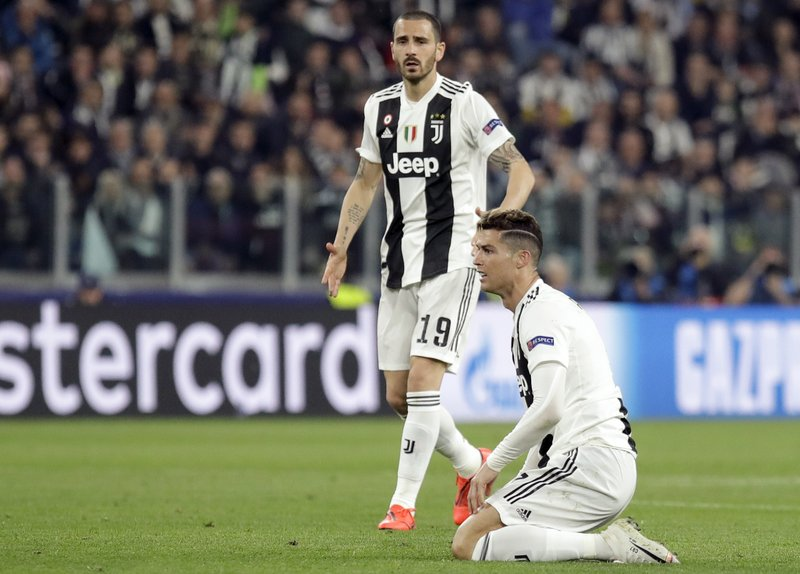 Juventus' Cristiano Ronaldo and Leonardo Bonucci, left, react during the Champions League, quarterfinal, second leg soccer match between Juventus and Ajax, at the Allianz stadium in Turin, Italy, Tuesday, April 16, 2019. (AP Photo/Luca Bruno)