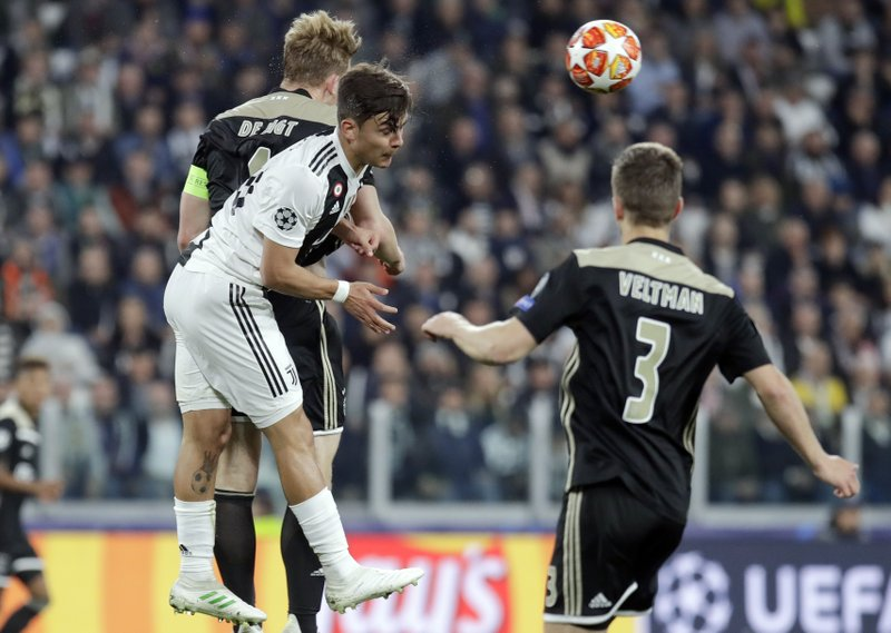 From left, Ajax's Matthijs de Ligt, Juventus' Paulo Dybala and Ajax's Joel Veltman go foe the ball during the Champions League, quarterfinal, second leg soccer match between Juventus and Ajax, at the Allianz stadium in Turin, Italy, Tuesday, April 16, 2019. (AP Photo/Luca Bruno)