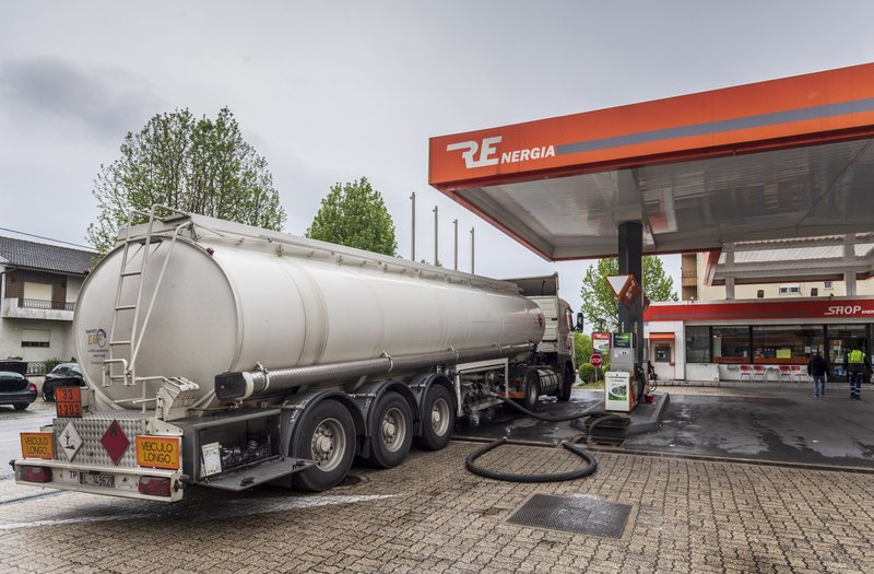 A tank truck delivers fuel at a gas station in Braga, northern Portugal, Wednesday, April 17, 2019. A strike over pay and working conditions by some 800 truckers who transport hazardous materials prompted a rush to fill tanks, leaving dry hundreds of gas stations across Portugal Wednesday. (AP Photo/Luis Vieira)
