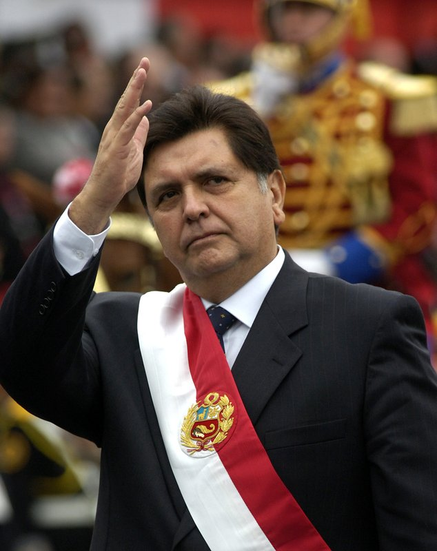 FILE - In this July 29, 2006 file photo, Peruvian President Alan García waves to supporters as he arrives at a military parade marking Independence Day in Lima, Peru. (AP Photo/Karel Navarro, File)