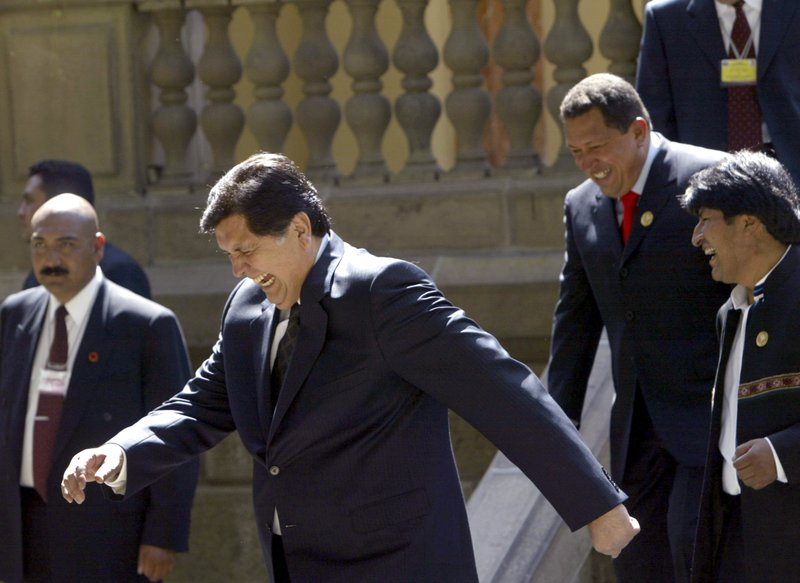 FILE - In this Dec. 9, 2006 file photo, Peru's President Alan García laughs out accompanied by Venezuelan President Hugo Chavez and of Bolivian President Evo Morales, as they break apart after gathering for a group photo at the Community of South American Nations summit, in Cochabamba, Bolivia. (AP Photo/Dado Galdieri, File)