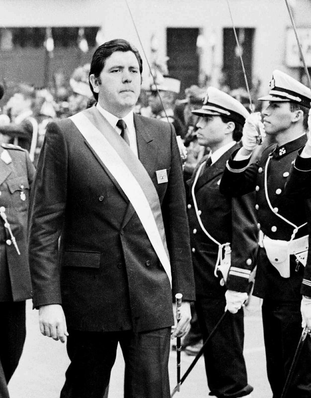 FILE - In this July 28, 1988 file photo, Peruvian President Alan García marches in front of palace guards at a military ceremony in Lima, Peru. (AP Photo, File)
