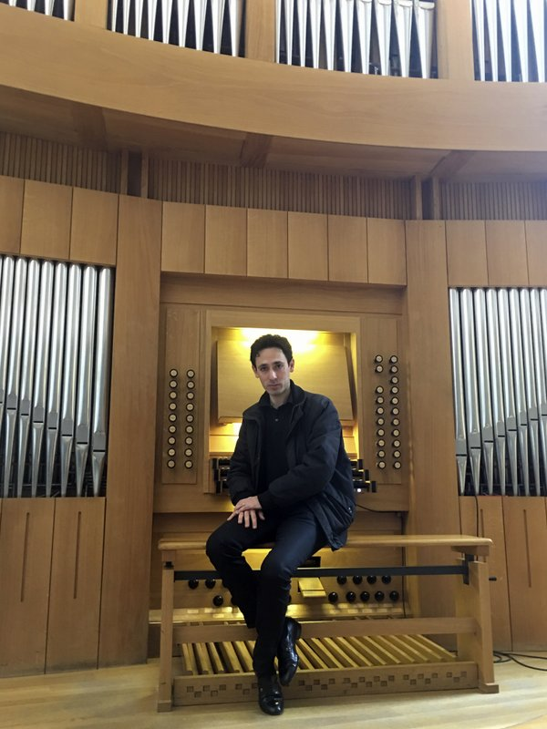 Vincent Dubois, organist at the Great Organ of Notre-Dame de Paris, poses at the organ at Strasbourg Conservatoire (music school), eastern France, Wednesday April 17, 2019. (AP Photo/Sylvain Plazy)