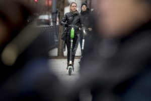 Shared electric scooters surge, overtaking docked bikes