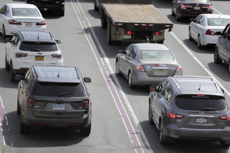 Vehicles bearing license plates from New York, New Jersey, Connecticut and Pennsylvania line up before at the George Washington Bridge toll plaza, Wednesday, April 17, 2019, in Fort Lee, N. (NJ-5) and Rep. Bill Pascrell (NJ-9) held a news conference to announce they plan to fight back against New York City's proposed congestion tax on New Jersey commuters. The congressmen will propose legislation they say will ensure New Jersey motorists, who already pay up to $15 for bridge or tunnel tolls, won't be charged twice. New York's legislature approved a conceptual plan this month. that will allocate revenue to fix the city's mass transit system. New York would become the first American city to use so-called congestion pricing to reduce gridlock and fund mass transit improvements. (AP Photo/Julio Cortez)