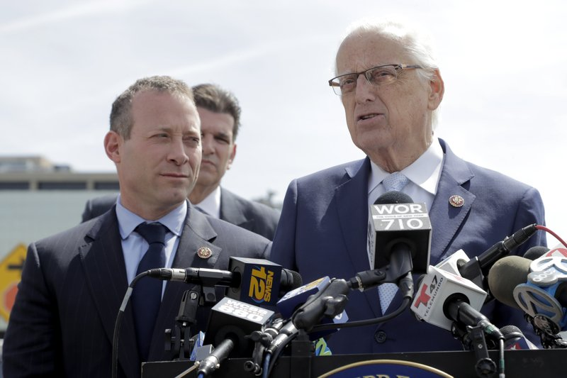 U.S. Rep. Bill Pascrell (NJ-9), right, stands with Rep. Josh Gottheimer (NJ-5), left, and and Fort Lee Mayor Mark Sokolich, back, during a news conference near the George Washington Bridge talking about the congressmen's plan to fight back against New York City's proposed congestion tax on New Jersey commuters, Wednesday, April 17, 2019, in Fort Lee, N. (AP Photo/Julio Cortez)