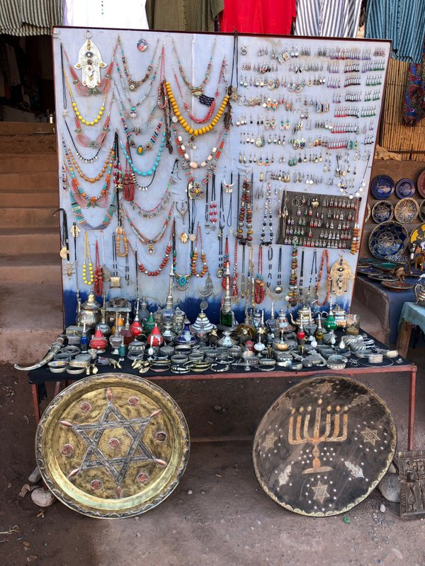 This Jan. 16, 2019, photo shows platters adorned with a menorah and Jewish stars in an outdoor stall near Ksar of Ait-Ben-Haddou in southern Morocco. (Leanne Italie via AP)