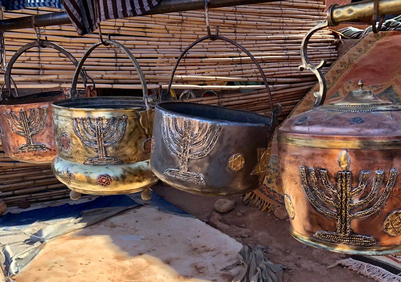 This Jan. 16, 2019, photo shows cooking pots adorned with menorahs in an outdoor stall near Ksar of Ait-Ben-Haddou in southern Morocco. (Leanne Italie via AP)