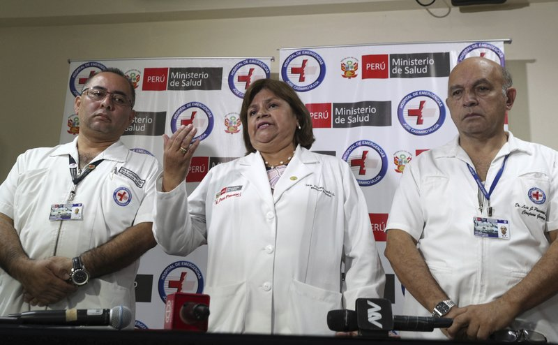 Health Minister Zulema Tomas, center, speaks at a news conference at the Casimiro Ulloa hospital where former Peruvian President Alan Garcia was taken after he shot himself, in Lima, Peru, Wednesday, April 17, 2019. (AP Photo/Martin Mejia)