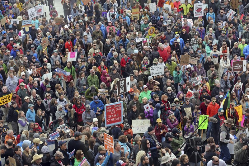 FILE - In this Dec. 2, 2017, file photo, supporters of the Bears Ears and Grand Staircase-Escalante National Monuments gather during a rally, in Salt Lake City. (AP Photo/Rick Bowmer, File)