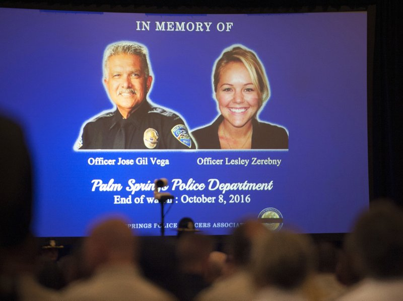 FILE - In this Oct. 18, 2016, file photo, images of slain Palm Springs, Calif., police officers Jose