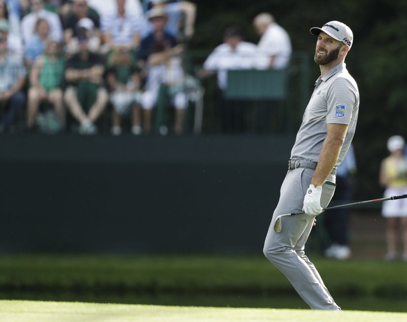 Dustin Johnson reacts after missing his putt on the 15th hole during the third round for the Masters golf tournament Saturday, April 13, 2019, in Augusta, Ga. (AP Photo/Marcio Jose Sanchez)