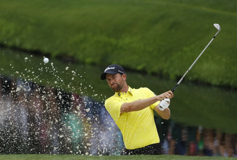 Webb Simpson hits from a bunker on the 16th hole during the final round for the Masters golf tournament, Sunday, April 14, 2019, in Augusta, Ga. (AP Photo/Matt Slocum)
