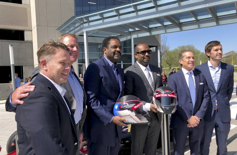 Officials from NASCAR, NHRA and IndyCar pose for a photo in Maryland Heights, Mo., a suburb of St. Louis, Wednesday, April, 17, 2019, after the announcement that Gateway Motorsports Park will be renamed World Wide Technology Raceway at Gateway. (AP Photo/Jim Salter)