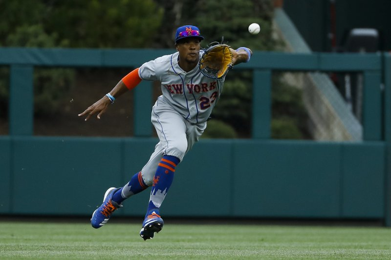 New York Mets center fielder Keon Broxton catches an RBI-sacrifice fly by Philadelphia Phillies' Maikel Franco during the second inning of a baseball game, Wednesday, April 17, 2019, in Philadelphia. (AP Photo/Matt Slocum)