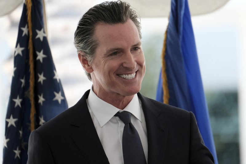 California Governor Gavin Newsom talks during a news conference at Rancho Los Amigos National Rehabilitation Center in Downey, Calif. (AP Photo/Richard Vogel)