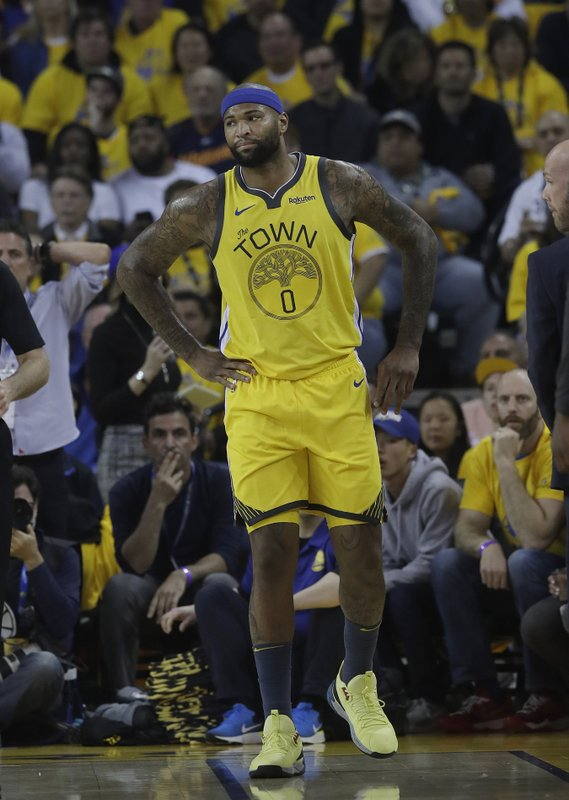 Golden State Warriors center DeMarcus Cousins reacts after injuring his leg during the first half of Game 2 of a first-round NBA basketball playoff series against the Los Angeles Clippers in Oakland, Calif. (AP Photo/Jeff Chiu)