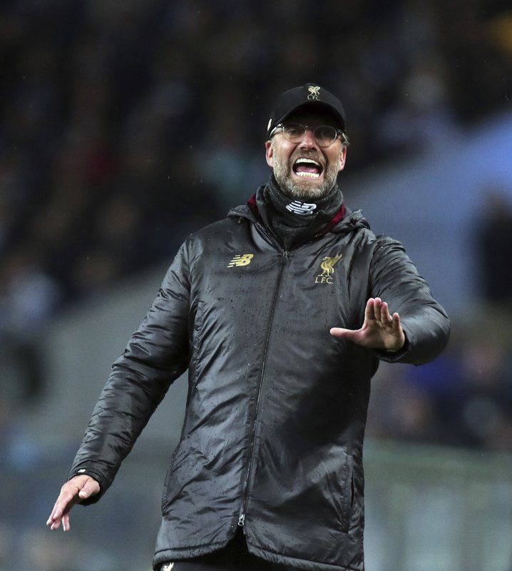 Liverpool manager Juergen Klopp gives instructions to his players during the Champions League quarterfinals, 2nd leg, soccer match between FC Porto and Liverpool at the Dragao stadium in Porto, Portugal, Wednesday, April 17, 2019. (AP Photo/Luis Vieira)