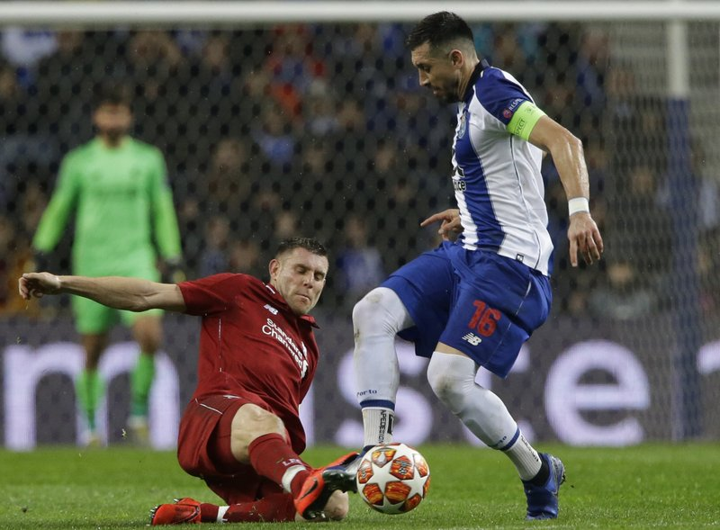 Porto midfielder Hector Herrera, right, is challenged by Liverpool's James Milner during the Champions League quarterfinal, 2nd leg, soccer match between FC Porto and Liverpool at the Dragao stadium in Porto, Portugal, Wednesday, April 17, 2019. (AP Photo/Armando Franca)