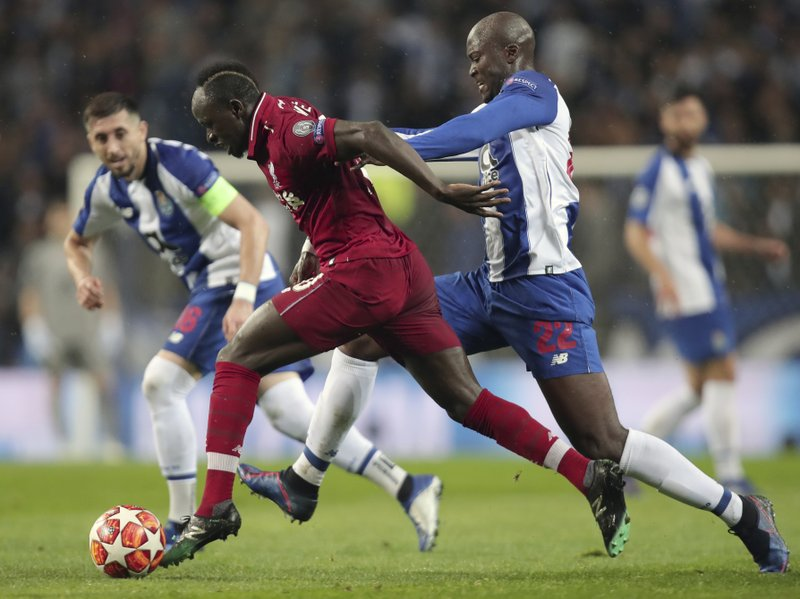 Liverpool's Sadio Mane, left, duels for the ball with Porto midfielder Danilo during the Champions League quarterfinals, 2nd leg, soccer match between FC Porto and Liverpool at the Dragao stadium in Porto, Portugal, Wednesday, April 17, 2019. (AP Photo/Luis Vieira)
