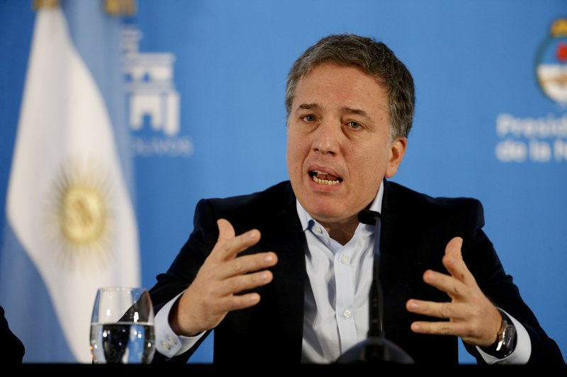 Argentina's Treasury Minister Nicolas Dujovne speaks during a press conference at Quinta de Olivos, the official presidential residence, in greater Buenos Aires, Argentina, Wednesday, April 17, 2019. (AP Photo/Natacha Pisarenko)