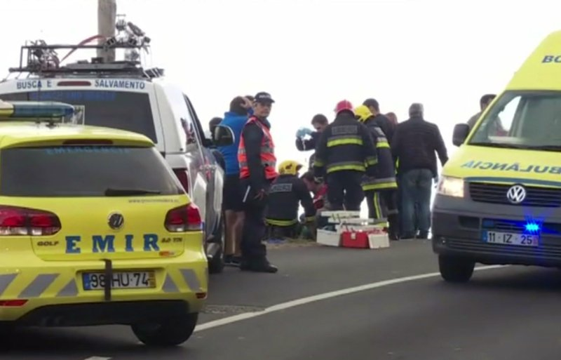 In this image from video, emergency services attend to injured at the scene after a tour bus crashed at Canico, on Portugal's Madeira Island, Wednesday April 17, 2019. (TVI via AP)