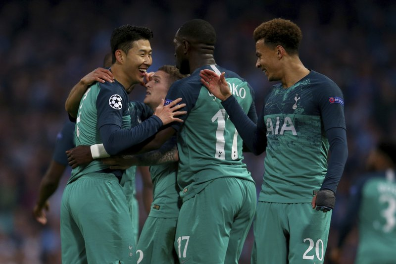 Tottenham's Son Heung-Min, left, celebrates scoring during the Champions League quarterfinal, second leg, soccer match between Manchester City and Tottenham Hotspur at the Etihad Stadium in Manchester, England, Wednesday, April 17, 2019. (AP Photo/Dave Thompson)